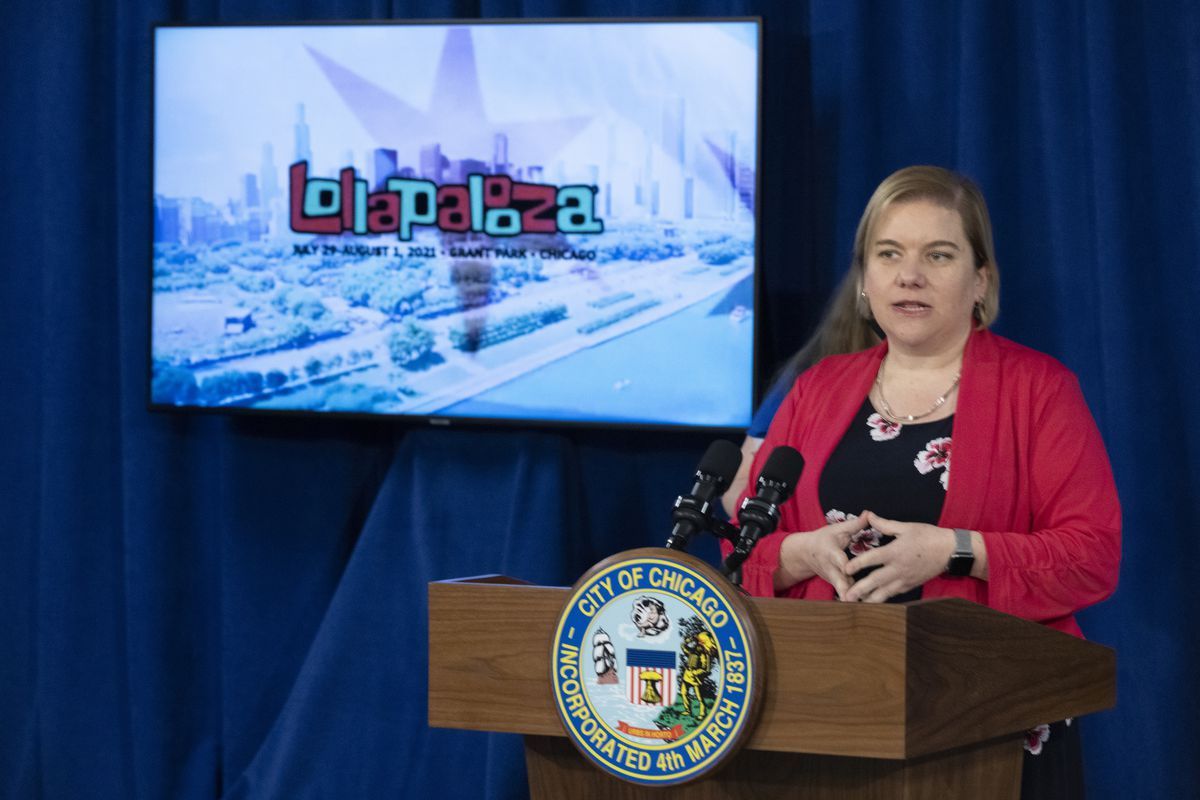 """Chicago Public Health Commissioner Dr. Allison Arwady speaks at a May 18 news conference. Despite an increase in cases, she said she's """"confident"""" Lollapalooza can be held safely."""