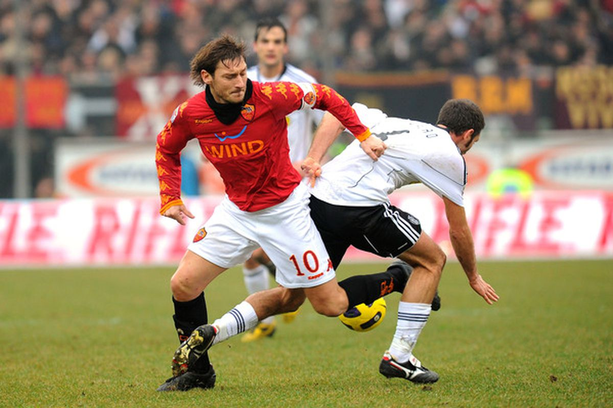 CESENA ITALY - JANUARY 16:  Francesco Totti (L) captain of Roma competes with Maurizio Lauro of Cesena during the Serie A match between Cesena and Roma at Dino Manuzzi Stadium on January 16 2011 in Cesena Italy.  (Photo by Roberto Serra/Getty Images)