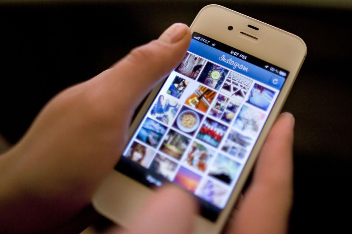 Instagram is demonstrated on an iPhone Monday, April 9, 2012, in New York. Facebook is spending $1 billion to buy the photo-sharing company Instagram in the social network's largest acquisition ever. Instagram lets people apply filters to photos they snap