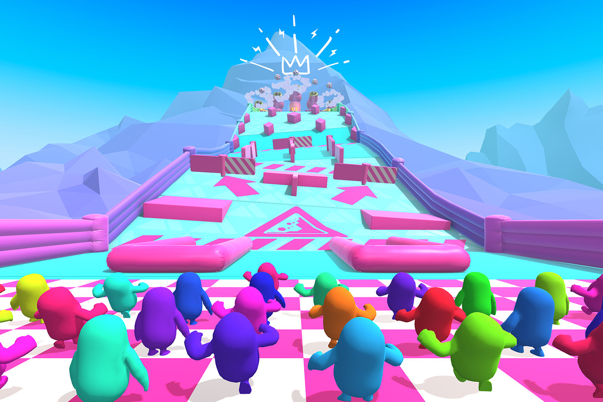 tiny colorful bloblike men run for their lives in Fall Guys: Ultimate Knockout