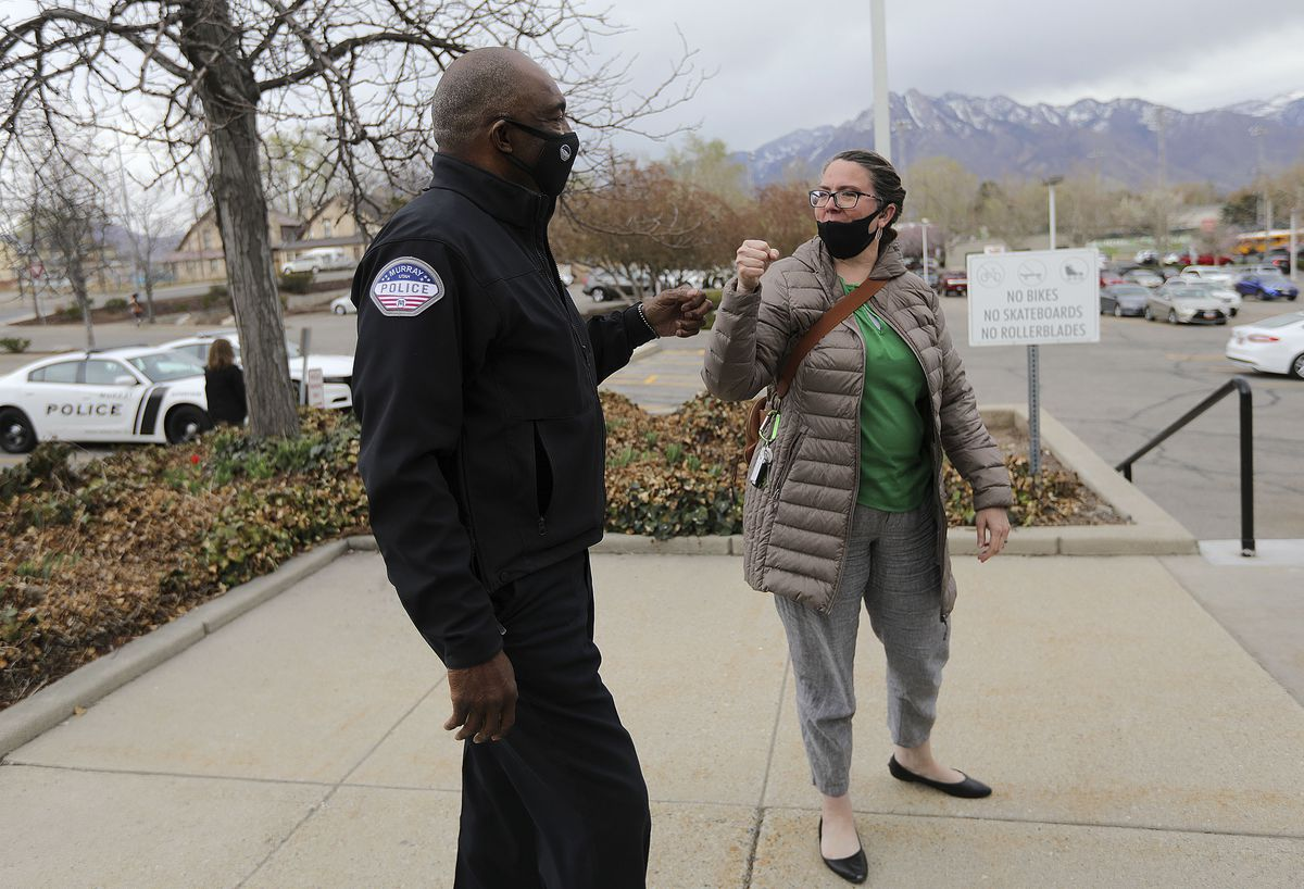 Murray Assistant Police Chief Joe Tarver gives a fist-bump to Jenefer Reudter, legal administrative supervisor for the Murray Attorney's Office, in Murray on Tuesday, April 13, 2021. It was the first time they had seen each other since the announcement that Tarver is leaving the police department to become chief of investigations for the Salt Lake County District Attorney's Office.