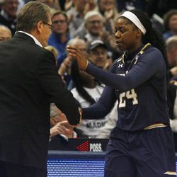 UConn head coach Geno Auriemma shakes hands with Notre Dame's Arike Ogunbowale (24) after UConn's win over the Notre Dame Fighting Irish in the Women's Jimmy V Classic at the XL Center in Hartford, CT on December 3, 2017.