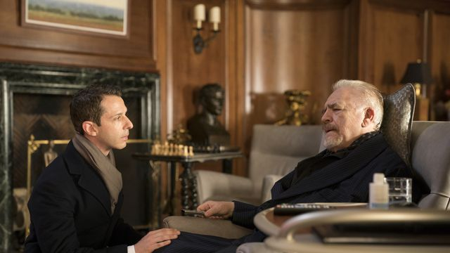 Kendall (Jeremy Strong) kneels in front of his father Logan (Brian Cox) in the first season of Succession