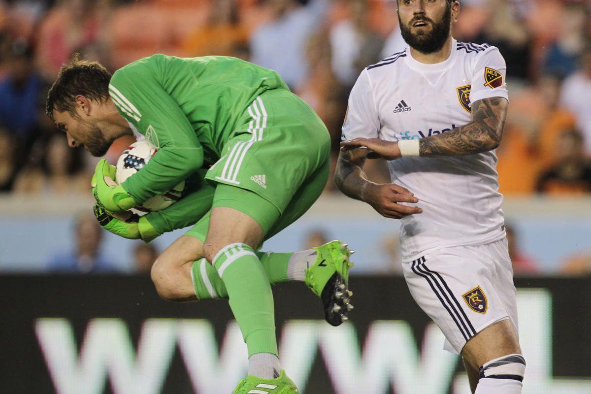 Houston Dynamo goalkeeper Tyler Deric (1) runs out and catches the ball  in front of Real Salt Lake forward Yura Movsisyan (14) during the first half of a MLS soccer game, Wednesday, May 31, 2017 in Houston. ( Yi-Chin Lee/Houston Chronicle via AP)