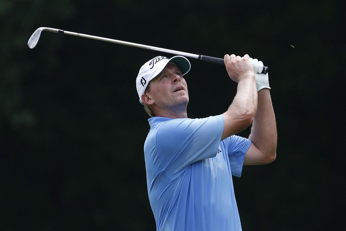 SILVIS, IL - JULY 10:  Steve Stricker hits his second shot on the sixth hole during the final round of the John Deere Classic at TPC Deere Run on July 10, 2011 in Silvis, Illinois.  (Photo by Michael Cohen/Getty Images)