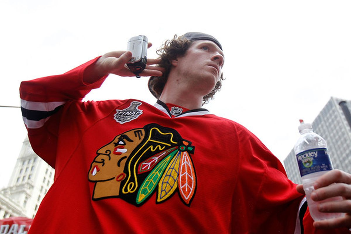 CHICAGO - JUNE 11: Colin Fraser #46 encourages the crowd to cheer during the Chicago Blackhawks Stanley Cup victory parade and rally on June 11, 2010 in Chicago, Illinois. (Photo by Jonathan Daniel/Getty Images)