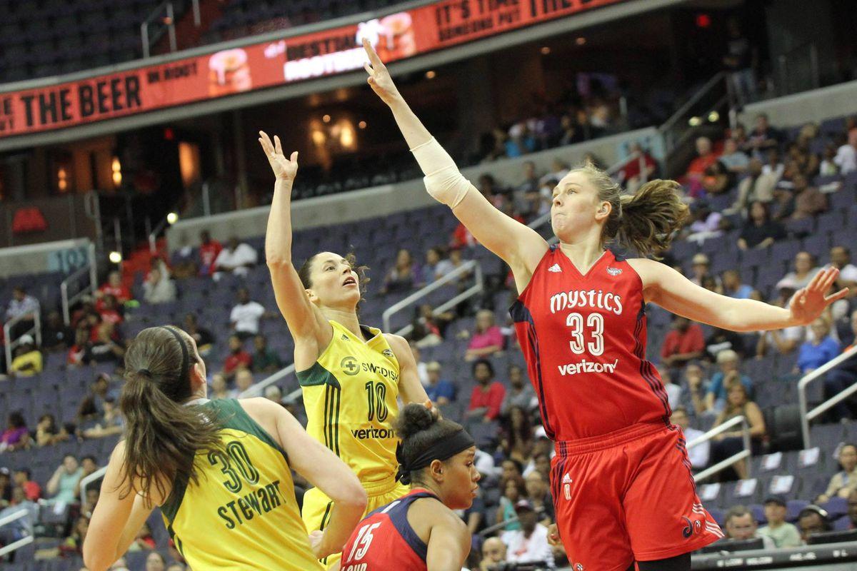 Washington Mystics F Emma Meesseman defends Seattle Storm G Sue Bird as she attempts a shot.
