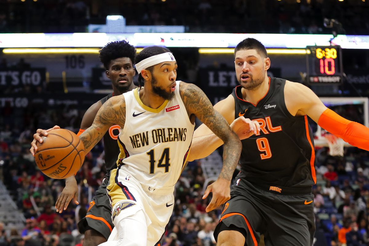New Orleans Pelicans forward Brandon Ingram drives past Orlando Magic center Nikola Vucevic during the second half at the Smoothie King Center.