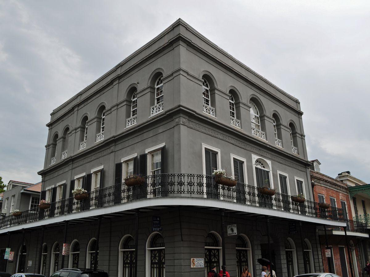A large grey mansion.