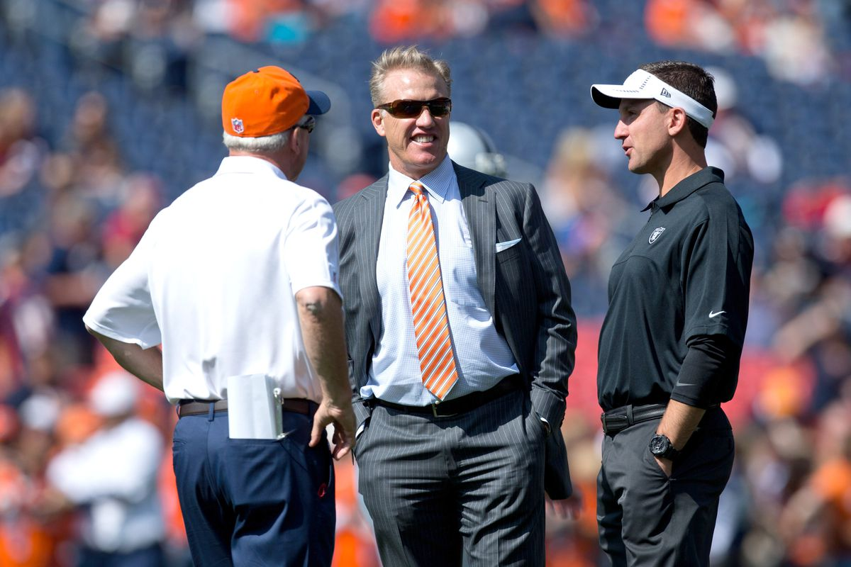 John Fox, John Elway, and Dennis Allen chat prior to a game between the Oakland Raiders and Denver Broncos