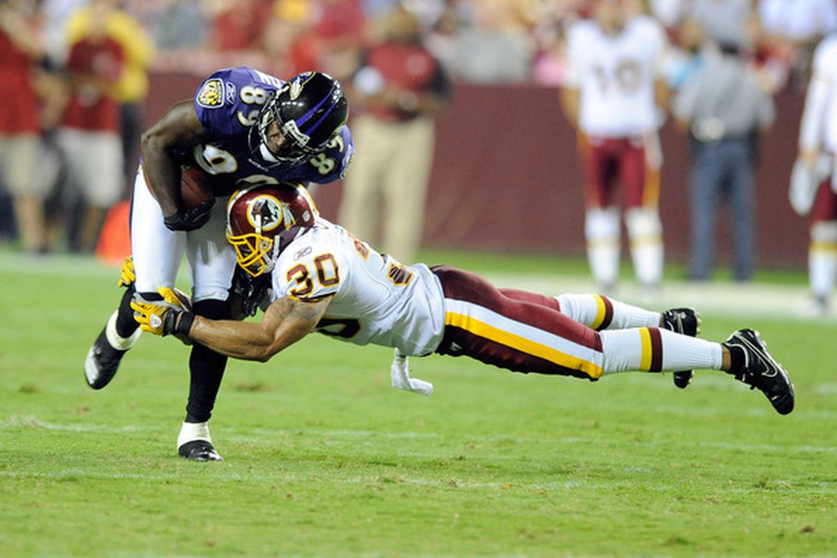 LANDOVER MD - AUGUST 21:  Mark Clayton #89 of the Baltimore Ravens is tackled during the preseason game by LaRon Landry #30 of the Washington Redskins at FedExField on August 21 2010 in Landover Maryland.  (Photo by Greg Fiume/Getty Images)