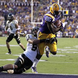 Idaho linebacker Homer Mauga (55) tries to tackle LSU wide receiver Kadron Boone (86) as he scores a touchdown on a pass play in the first half of their NCAA college football game in Baton Rouge, Saturday, Sept. 15, 2012.