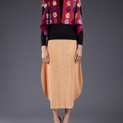 <b>Comme des Garçons</b> '90s sweater cape, $750. <b>Issey Miyake</b> '90s pleated skirt, $450.