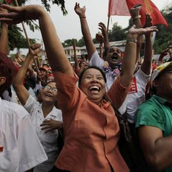 Aung San Suu Kyi's National League for Democracy party supporters cheer upon the party's announcement in Yangon, Myanmar, Sunday, April. 1, 2012. Supporters of Suu Kyi erupted in euphoric cheers Sunday after her party said she won a parliamentary seat in a landmark election, setting the stage for her to take public office for the first time.