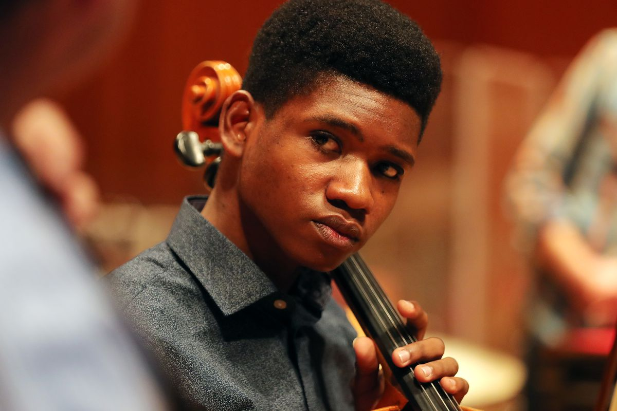 Getro Joseph a young cellist from Haiti, looks over at John Eckstein of the Utah Symphony as the two have a short practice session at Abravanel Hall in Salt Lake City on Saturday, Dec. 7, 2019. Getro also met with Congressman Ben McAdams, who assisted Getro with the visa process for his trip to Utah.