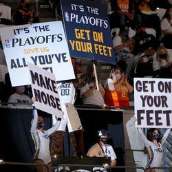 Jazz bear and a pair of Jazz dancers hold signs as the Utah Jazz and the Memphis Grizzlies prepare to play in game one of their NBA playoff series at Vivint Arena in Salt Lake City on Sunday, May 23, 2021.