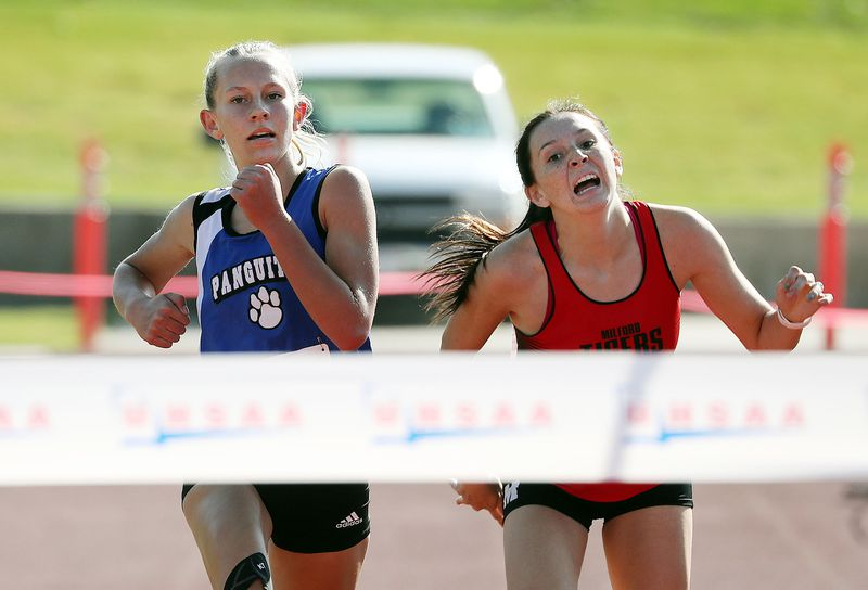 Adelaide Englestead of Panguitch, left, beats Kinley Spaulding of Milford to the ribbon in the 1A girls high school state cross-country championship race in Cedar City on Wednesday, Oct. 21, 2020.