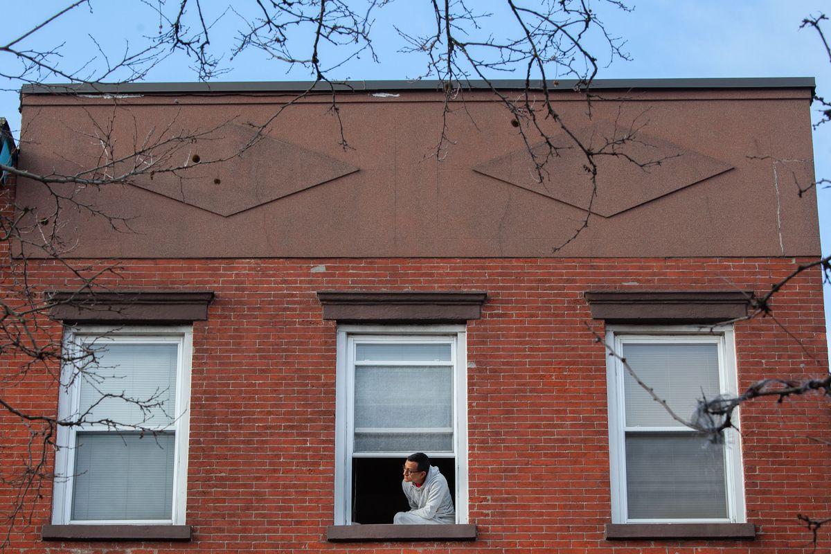 Cesar Cardenas gets some fresh air while quarantining in his Carroll Gardens apartment.