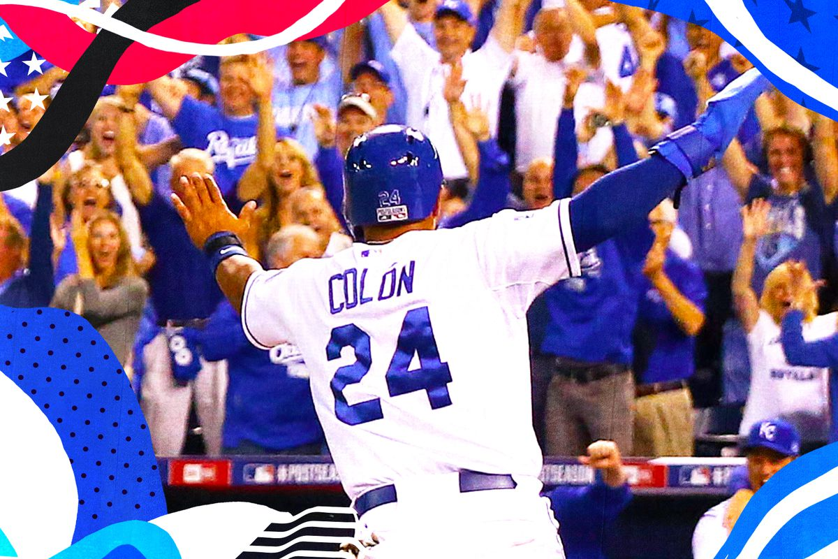 Royals pinch hitter Christian Colon celebrating as he scores winning run in 2014 AL Wild Card game with crowd cheering in front of him