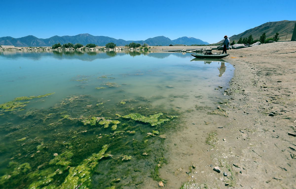 A fisherman disassembles his pontoon boat at Utah Lake's Lincoln Beach on Tuesday, June 23, 2020. The Utah Lake Commission and partners are pilot-testing two different treatments for algae at the lake. Lindon Marina and Lincoln Beach marina will both undergo treatments this summer. Both locations will be accessible for recreation use and the difference in water quality will be noticeable.