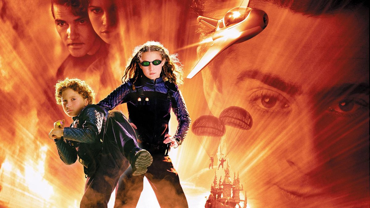 the cover of spy kids, where two kids in cool spy gear stand against an explosive looking background