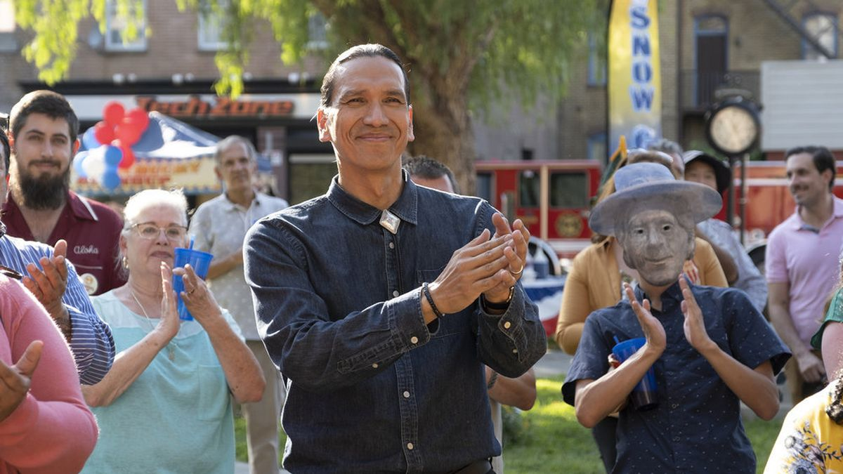 Terry Thomas, played by Michael Greyeyes, applauds at a park event in Peacock's Rutherford Falls