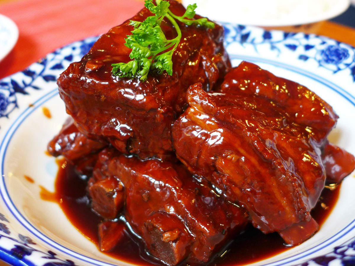 Sauced ribs on a blue and white plate