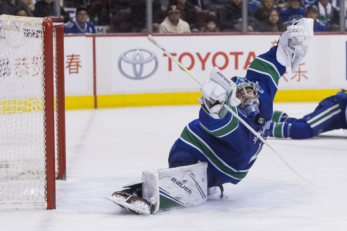 Feb 11, 2019; Vancouver, British Columbia, CAN; Vancouver Canucks goalie Michael Dipietro (75) misses a shot taken by San Jose Sharks forward Kevin Labanc (62) in the second period during a game at Rogers Arena. Mandatory Credit: Bob Frid