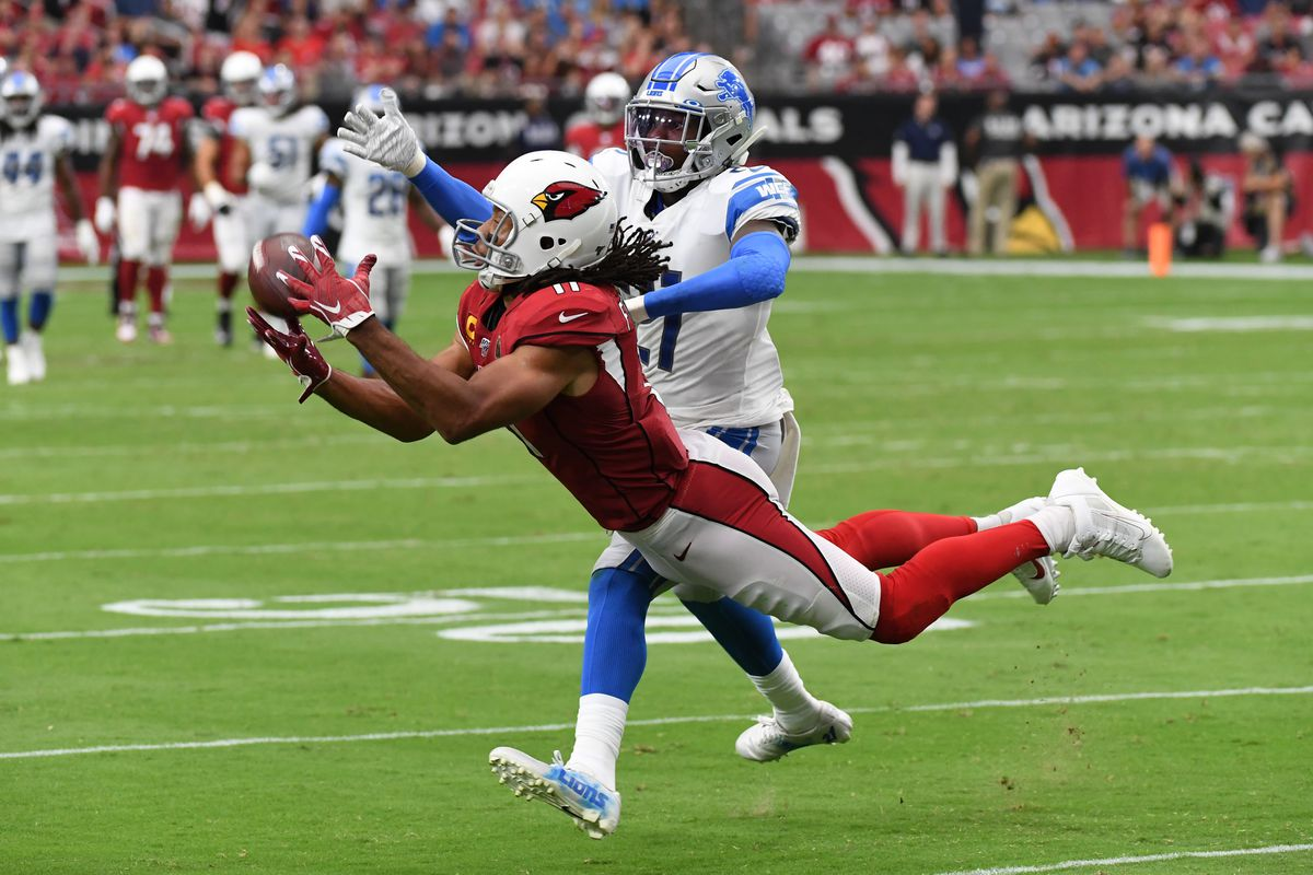 Wide receiver Larry Fitzgerald of the Arizona Cardinals makes a diving catch while being defended by safety Tracy Walker of the Detroit Lions during the fourth quarter at State Farm Stadium on September 08, 2019 in Glendale, Arizona.
