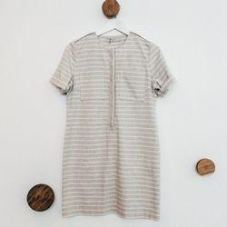 "Striped Pocket Shift Dress, <a href=""http://7115newyork.com/collections/apparel/products/striped-pocket-shift-dress-light-gray-stripes"">$148</a>"