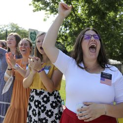 Sister Chyanne Kienitz a missionary for The Church of Jesus Christ of Latter-day Saints cheers as she watches the Days of '47 Parade in Salt Lake City on Friday, July 23, 2021.