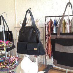 "<a href=""http://www.alexandrasatine.com/"">Venezuelan-made Alexandra Satine bags</a> and <a href=""http://siscoberluti.com/"">Sisco + Berluti bracelets</a>"