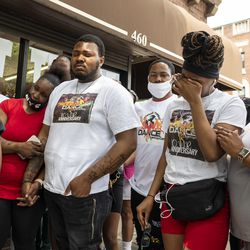 Dancers with Ultimate Threat Dance Organization, family and friends, cry and comfort each during a press conference at the dance studio, Thursday, May 20, 2021. Verndell Smith, the founder of the dance studio was shot and killed yesterday.
