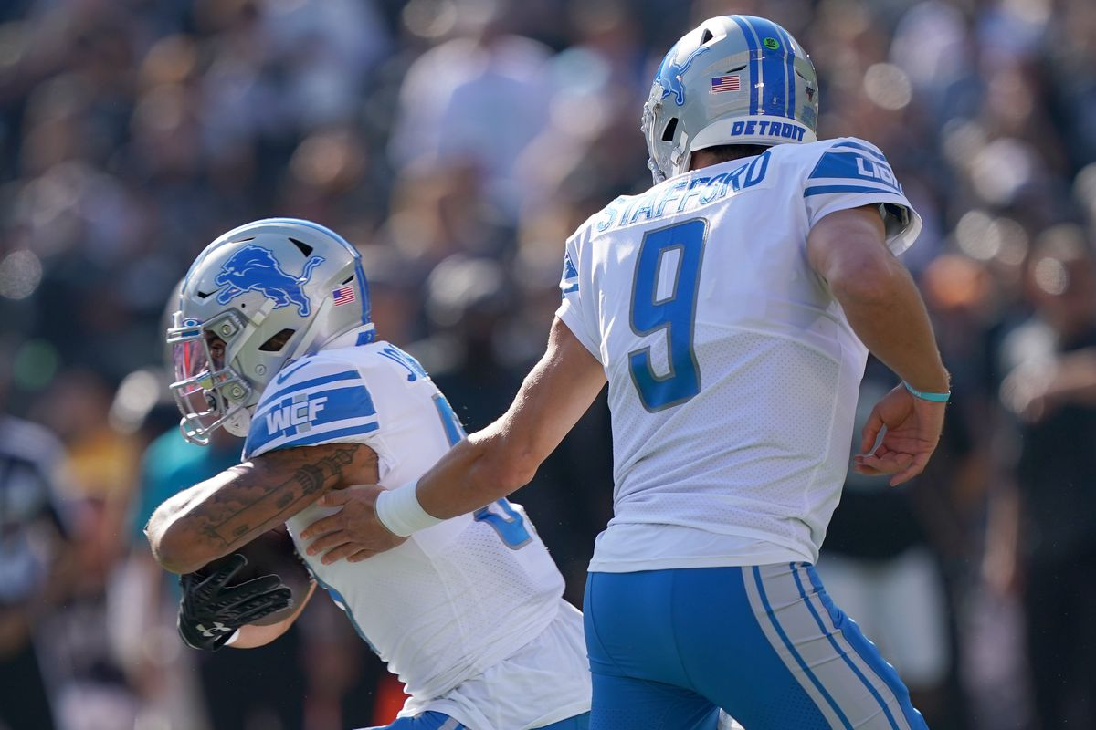 Ty Johnson of the Detroit Lions takes the handoff from Matthew Stafford against the Oakland Raiders during the first quarter of an NFL football game at RingCentral Coliseum on November 03, 2019 in Oakland, California.