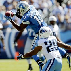 Detroit Lions wide receiver Nate Burleson (13) catches a pass as he is defended by Tennessee Titans cornerback Ryan Mouton (29) in the first quarter of an NFL football game, Sunday, Sept. 23, 2012, in Nashville, Tenn.