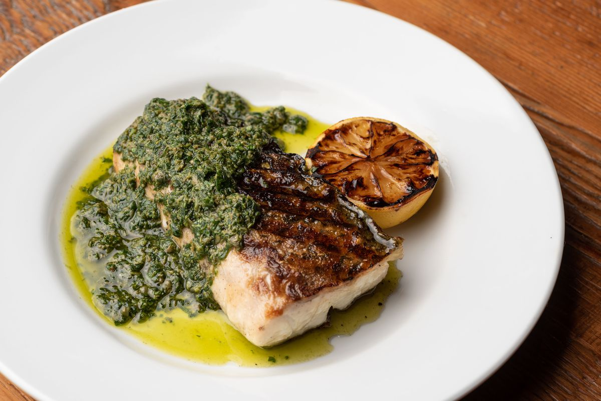 A long piece of white fish grilled and topped with an anchovy caper sauce.