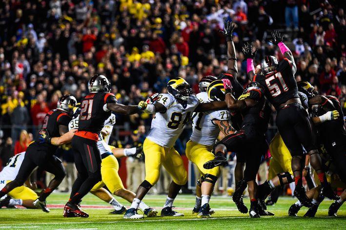 Kemoko Turay blocking the Michigan kick. (Alex Goodlett)