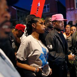 Jennifer Hudson (2nd L) and Chance the Rapper (2nd R) take part | Jim Young/Getty Images