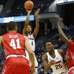 UConn's Jalen Adams (4) puts up a shot from the outside.