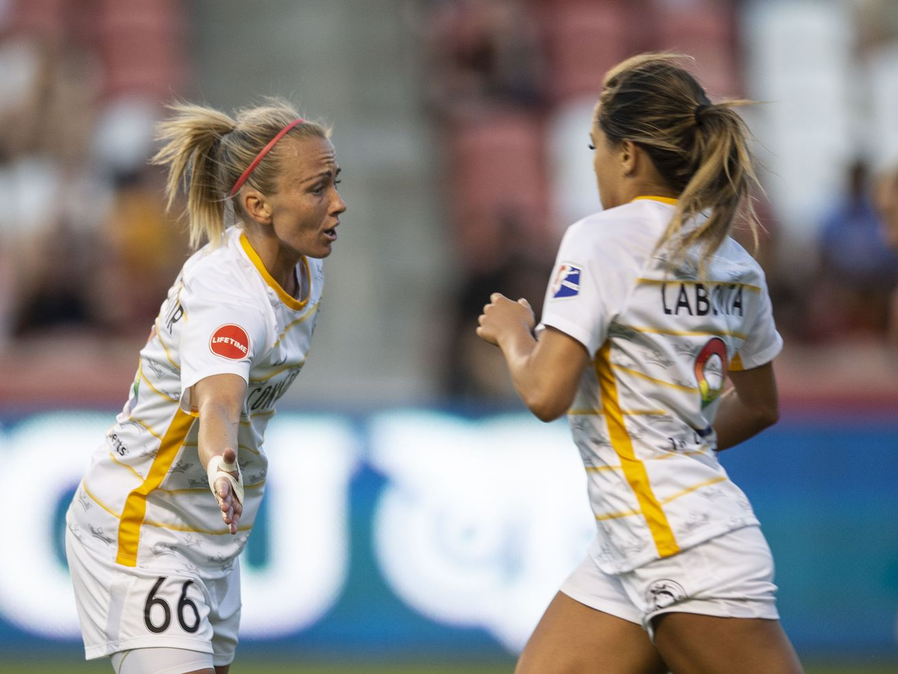 Utah Royals FC midfielder Gunnhildur Jónsdóttir (66) high-fives Utah Royals FC midfielder Lo'eau LaBonta (9) during their match against the Seattle Reign FC at Rio Tinto Stadium in Sandy on Friday, June 28, 2019.