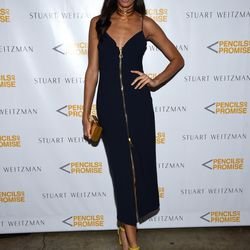 Joan Smalls wears the Stuart Weitzman 'Nearlynude' sandal in limited-edition yellow and an Ellery dress.