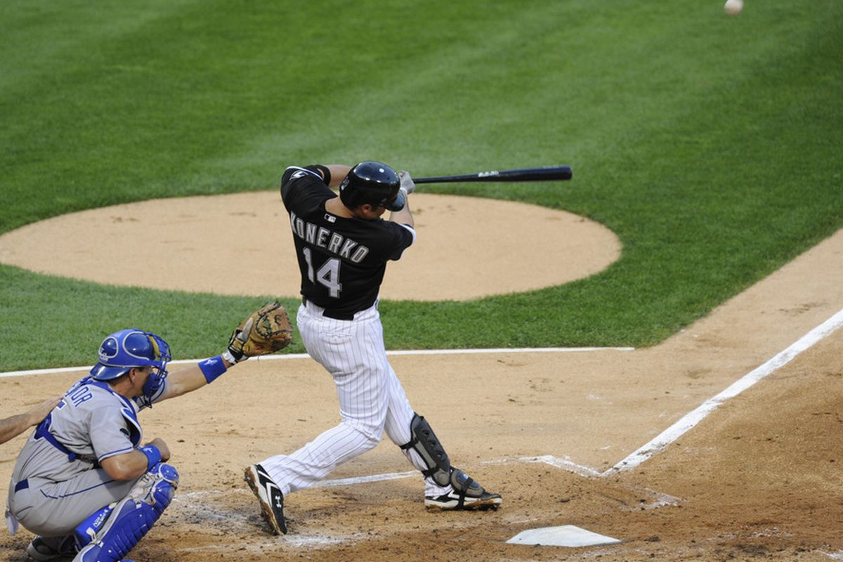 CHICAGO, IL - JULY 05:  Paul Konerko # 14 of the Chicago White Sox hits a solo home run in the second inning against the Kansas City Royals on July 5, 2011 at U.S. Cellular Field in Chicago, Illinois.  (Photo by David Banks/Getty Images)