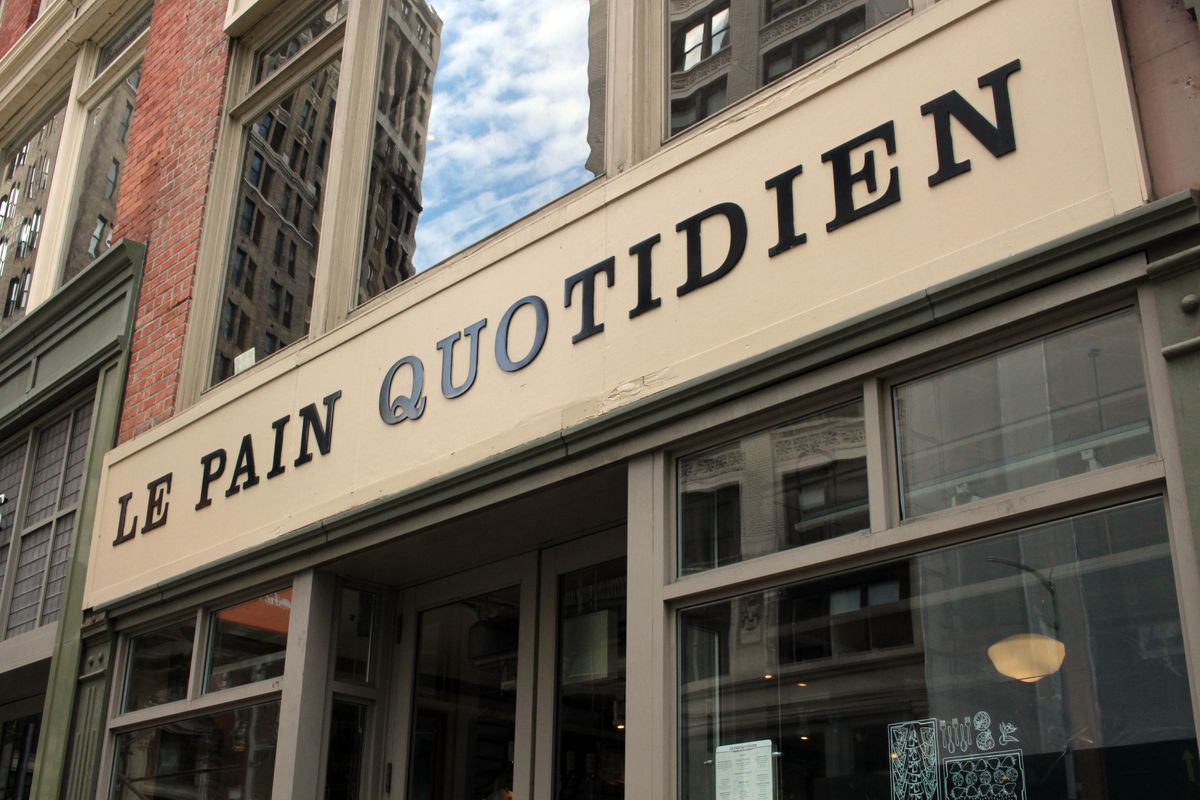 The exterior of the bakery Le Pain Quotidien with the letters seen in black
