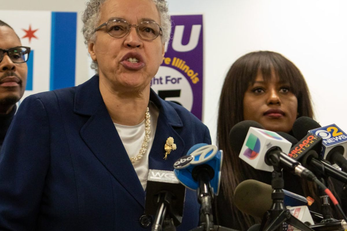 Cook County Board President Toni Preckwinkle speaks at a press conference in December, where she received endorsements from several public worker unions, including the Chicago Teachers Union, whose Vice President Stacy Davis Gates stands just to Preckwinkle's right in this picture.