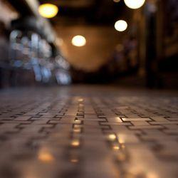 Basket-weave marble tile floors give a retro feeling