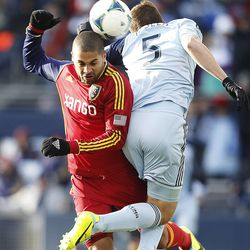Real's Alvaro Saborio and Kansas City's Matt Besler go after the ball as Real Salt Lake and Sporting KC play Saturday, Dec. 7, 2013 in MLS Cup action.