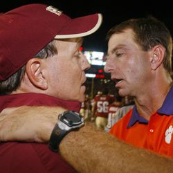 Florida State coach Jimbo Fisher, left, and Clemson coach Dabo Swinney meet after an NCAA college football game on Saturday, Sept. 22, 2012, in Tallahassee, Fla. Florida State won 49-37.