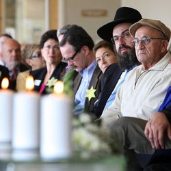 The audience listens as John Price speaks during a Utah Holocaust Memorial Commemoration at the Jewish Community Center in Salt Lake City, Thursday, April 19, 2012.