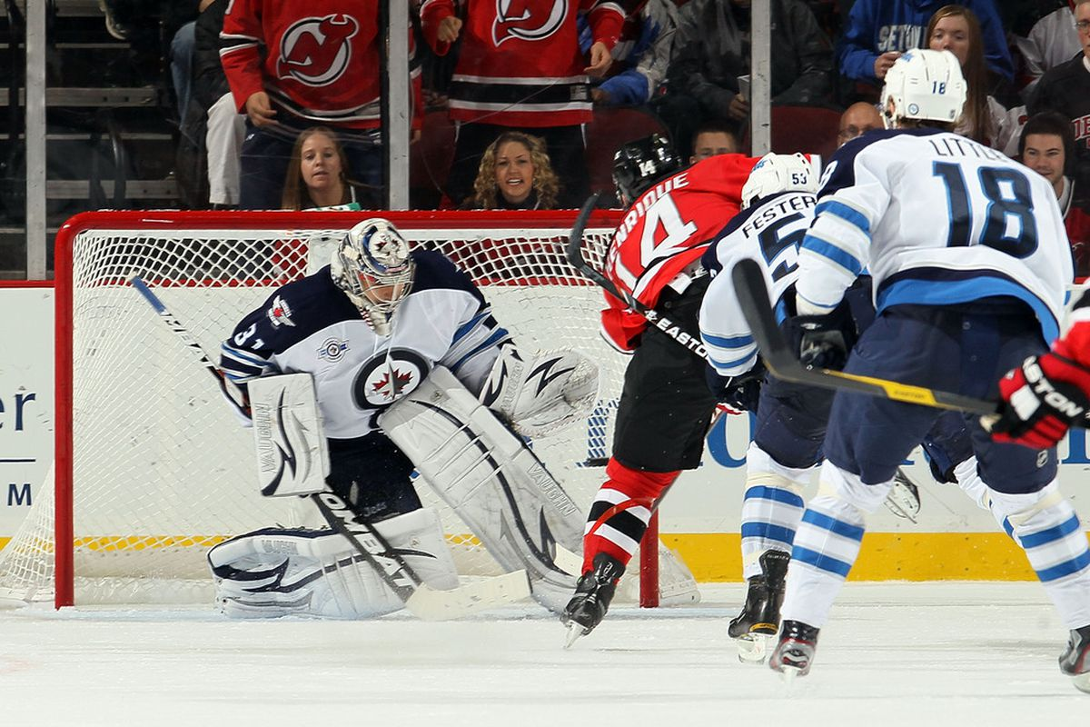 Pictured: Adam Henrique achieving victory.  Alternate Caption: Adam Henrique turns Ondrej Pavelec into the starter for the Lose-ipeg Jets. (Photo by Jim McIsaac/Getty Images)