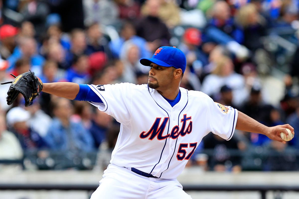 NEW YORK, NY - APRIL 11:  Johan Santana #57 of the New York Mets pitches against the Washington Nationals at Citi Field on April 11, 2012 in the Flushing neighborhood of the Queens borough of New York City.  (Photo by Chris Trotman/Getty Images)